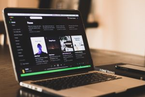 image of spotify on laptop computer
