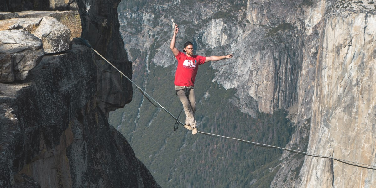 man walking a tightrope